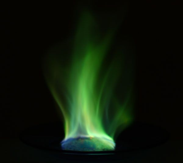 These green flames are produced by the emission of excited copper ions.