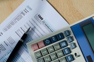 1040 income tax form and a calculator