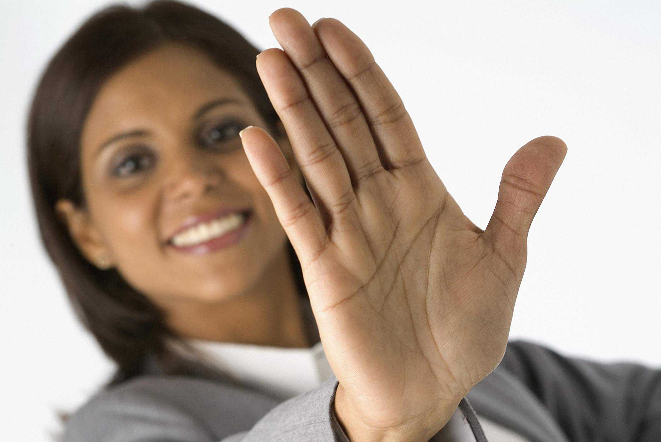 woman saying no with hand