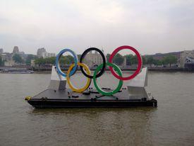 The Olympic rings on a barge on the river Thames.