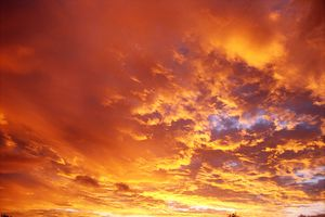 Clouds at sunset with a red tint.