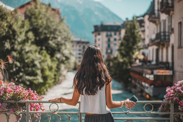 rear view of woman in Chamonix-Mont Blanc village and French alps