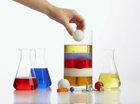 Density column showing colored liquids with different densities.