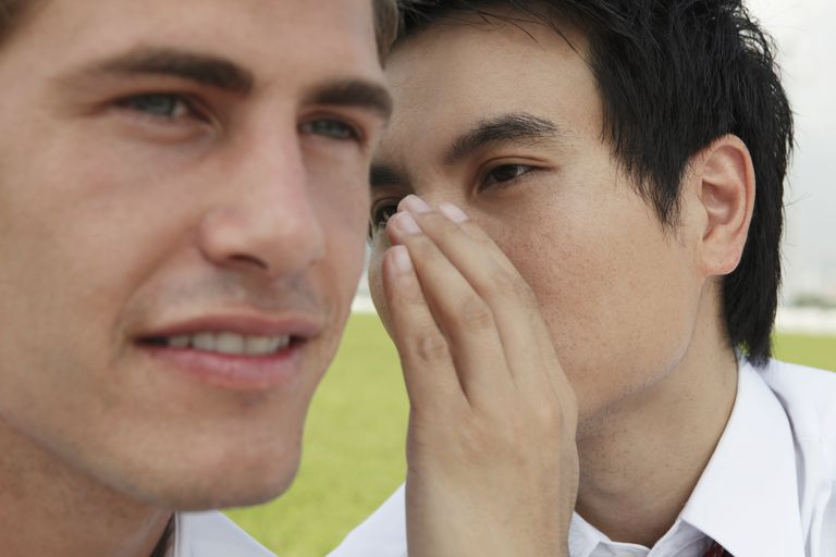 Close up of a man whispering