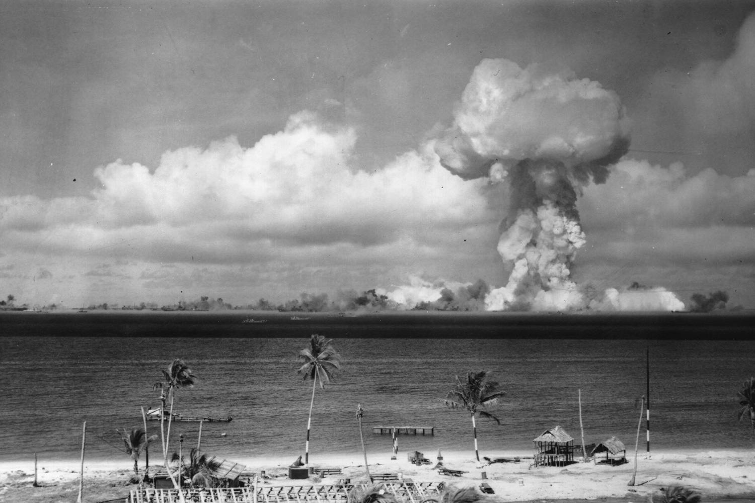 A mushroom cloud forms after the initial atomic bomb test explosion off the coast of Bikini Atoll, Marshall Islands.
