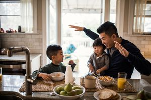 father and kids at breakfast table