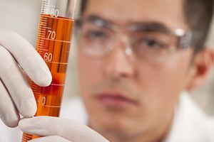 Scientist Checking a Solution in Graduated Cylinder