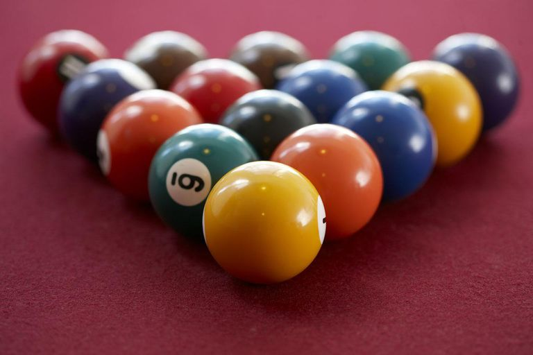 Balls of Snooker in a red table