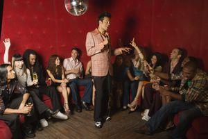 Man singing karaoke at nightclub