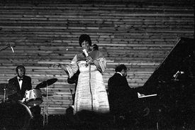 Ella Fitzgerald singing in front of a band.
