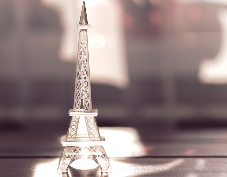 Miniature Eiffel Tower sitting in the sunlight.