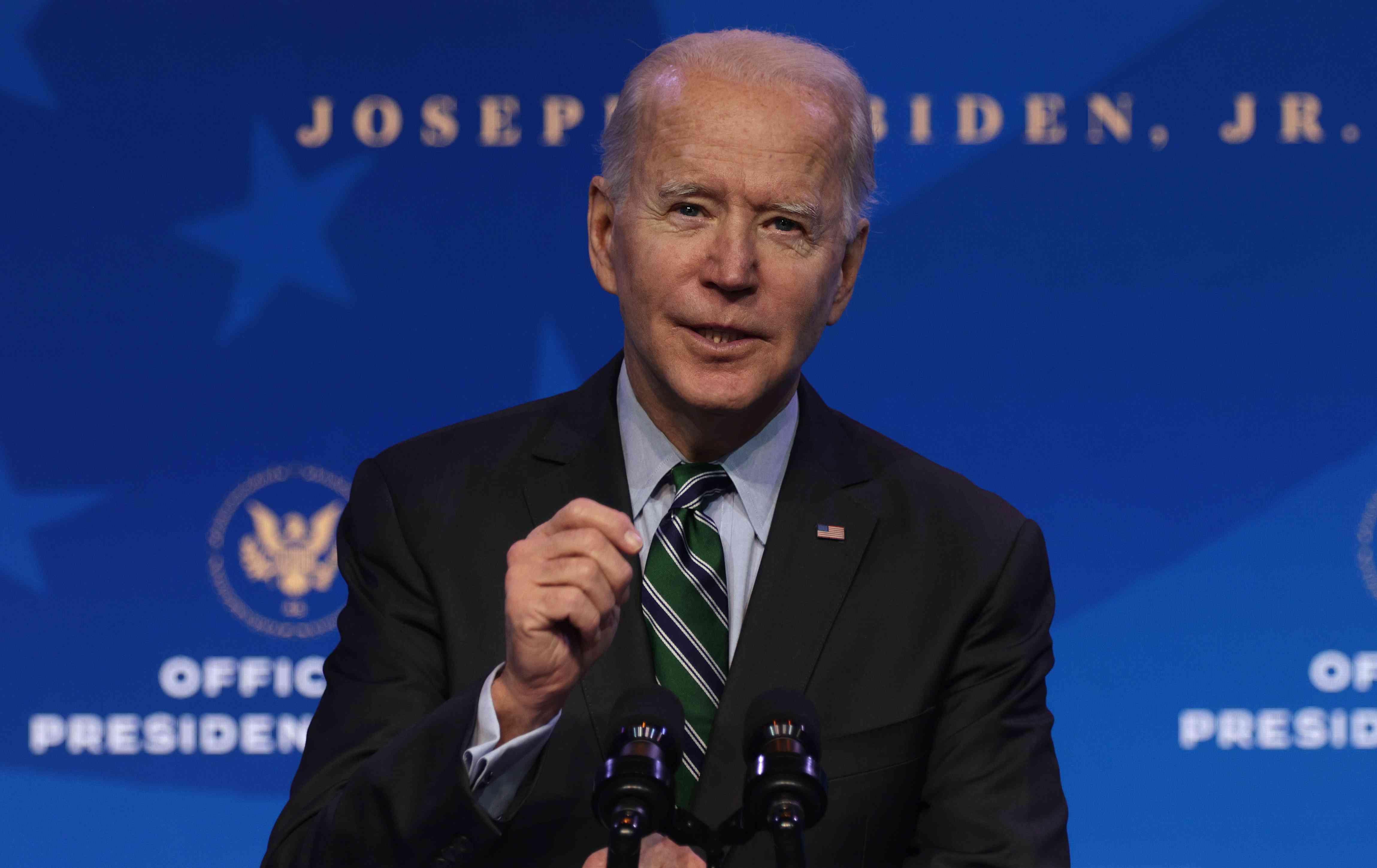 Joe Biden speaks behind a microphone