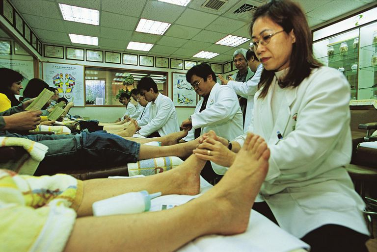 China, Taiwan, Taipei, reflexology therapists treating patients