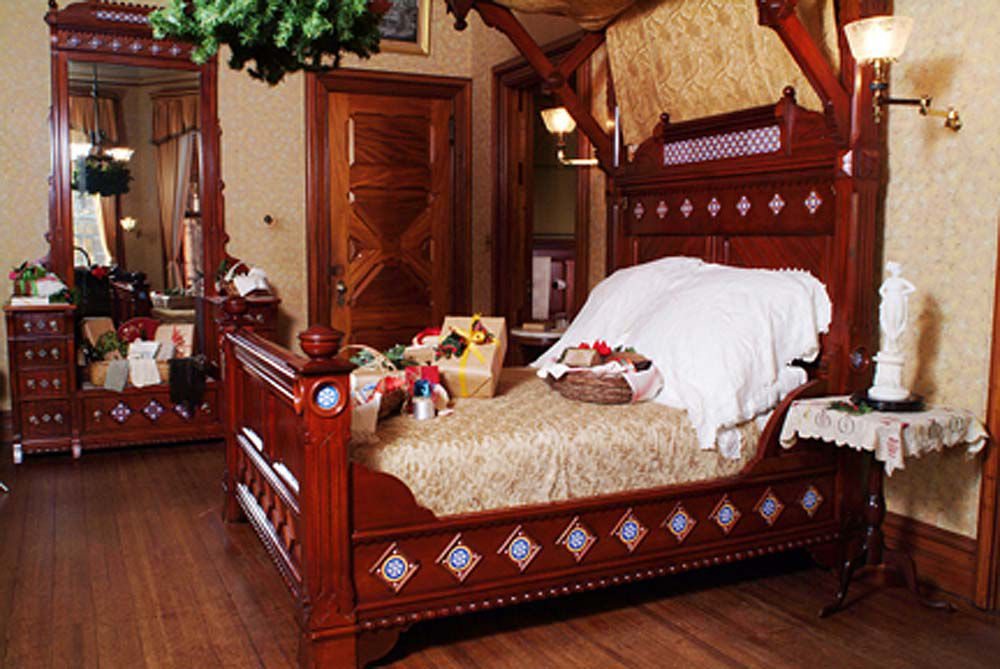 The luxurious guest bedroom adjacent to the library had mahogany furnishings.