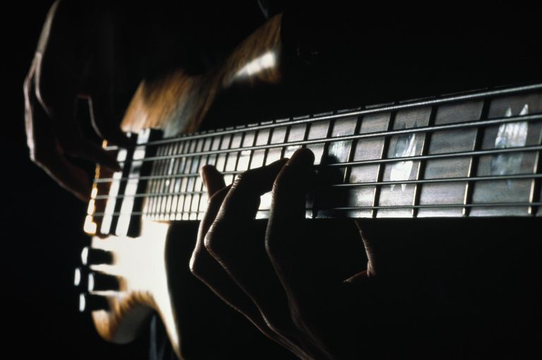 Five-stringed electric bass guitar, close-up of fretboard