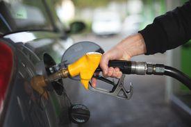 hand pumping gas