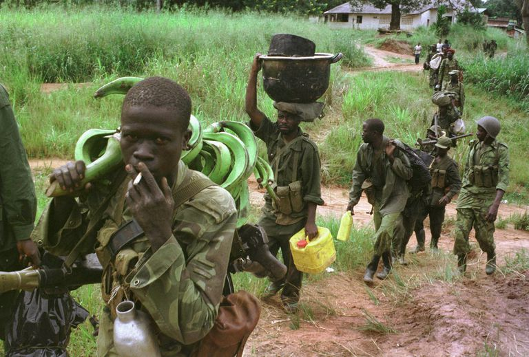 Rebel Army Advances in Congo carrying food and supplies.