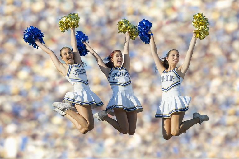 Cheerleaders Jumping in Mid-Air