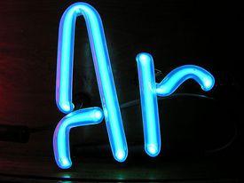 Argon glows violet in an electric field.