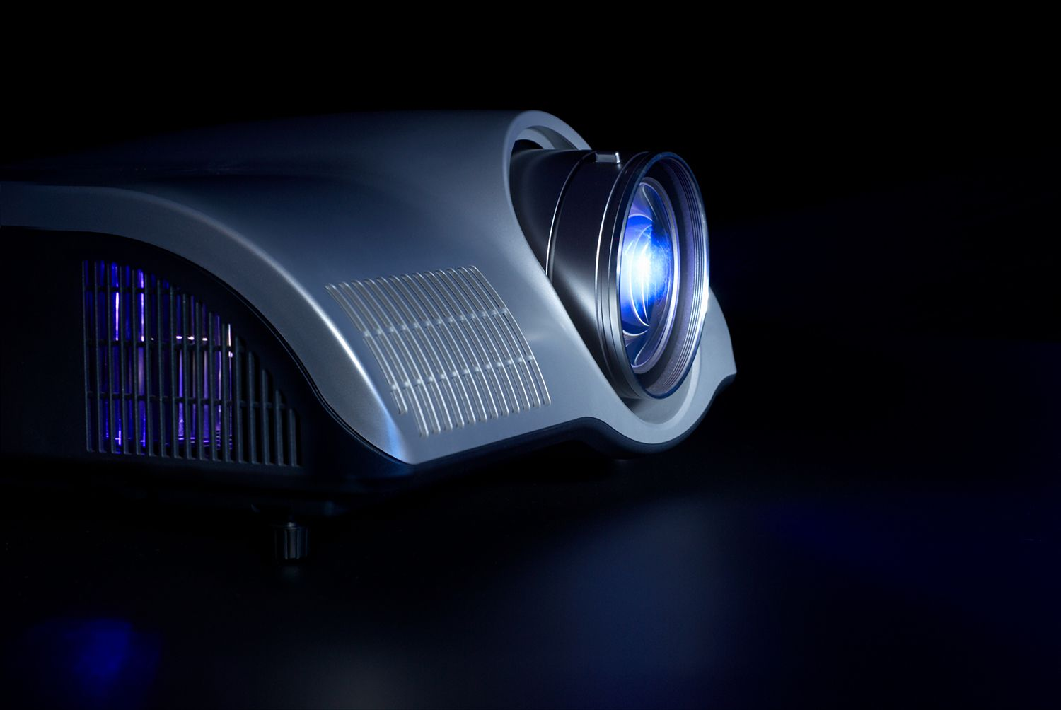 LCD home theater projector on black background.
