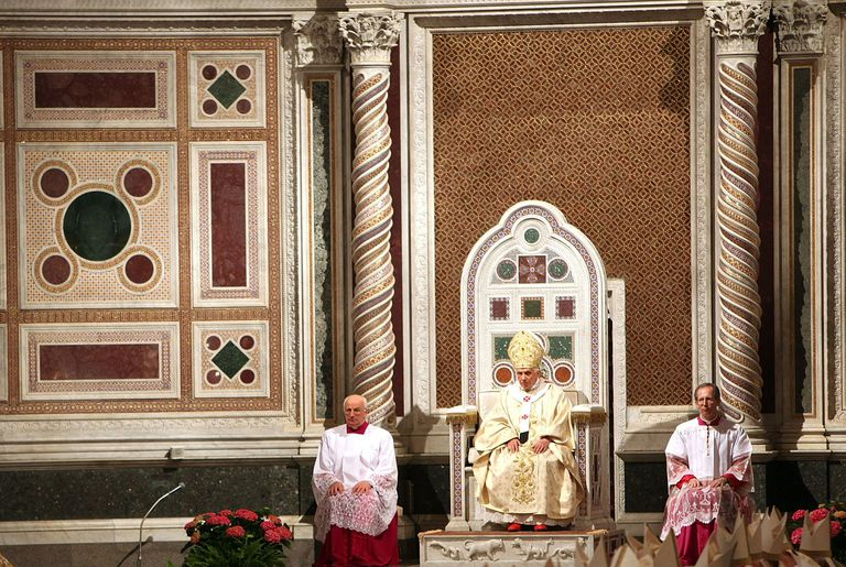 Pope benedict XVI sits between two Solomonic Columns at Basilica of Saint John Lateran, Rome