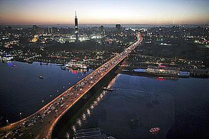 """Cars drive on a bridge crossing the Nile River on February 9, 2006 in Central Cairo, Egypt. Cairo is still the heart of Egypt and is allegorically called """"the Mother of World"""""""