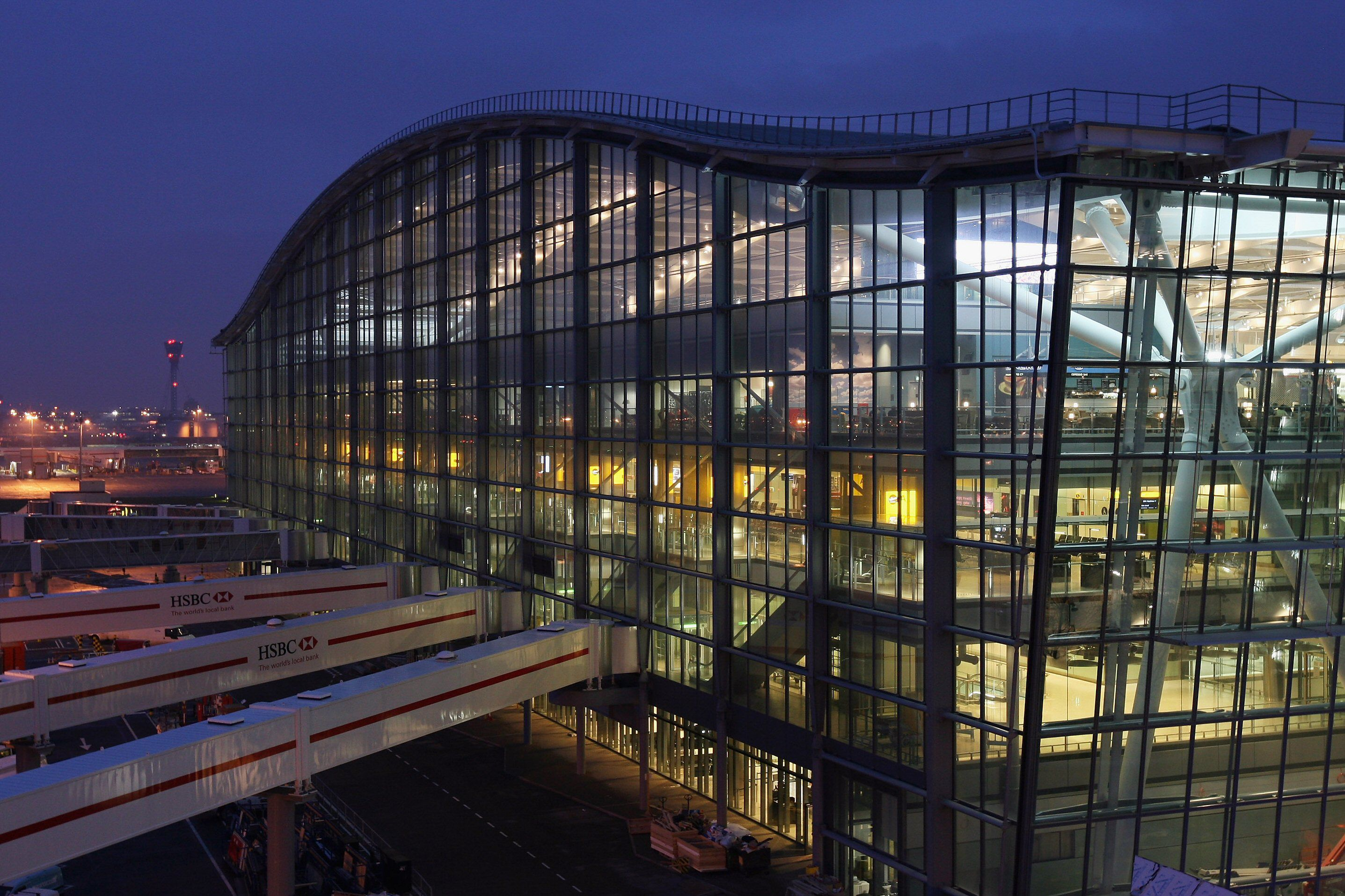 large glass building with curved roof