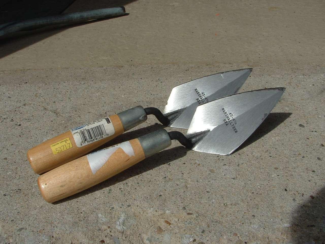 Two brand new, neatly sharpened Marshalltown trowels