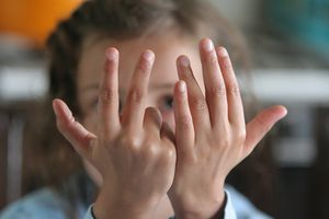 Girl counting on fingers