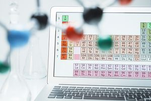Lap Top With Periodic Table and Ball and Stick Molecular Model