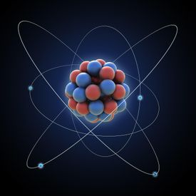 Graphic of an atom with nucleus and electrons in their orbits