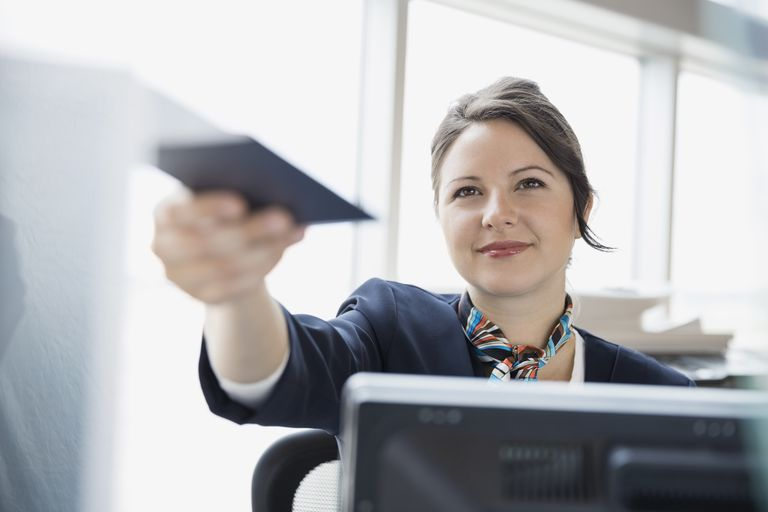 Airport customer service representative holding passport