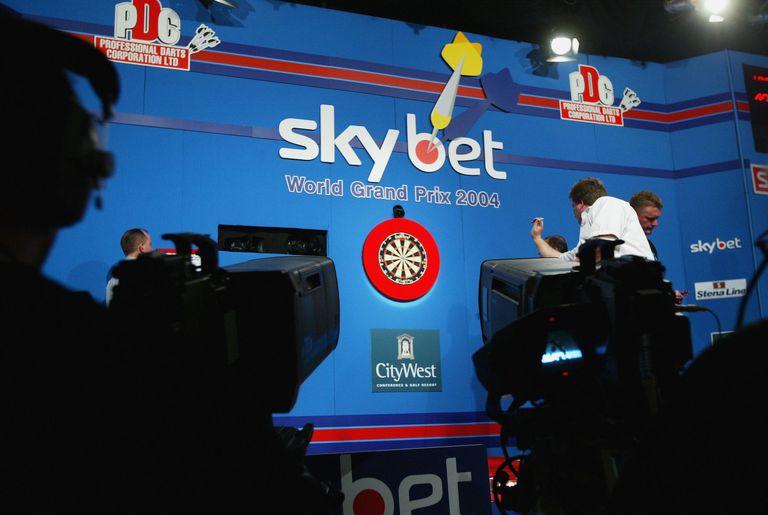 A man holding a dart at the Skybet World Darts Grand Prix Final