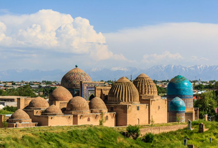 Medieval mausoleums echo the distant mountains' shapes, Samarkand, Uzbekistan.