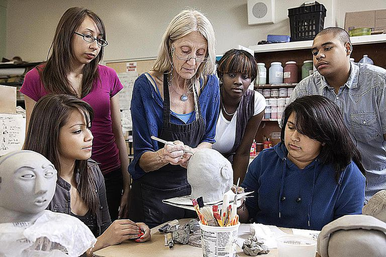 Teacher demonstrating sculpting to students