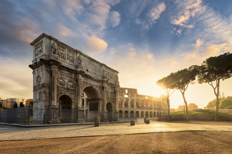 Arch of Constantine with the Colosseum in the background at sunrise, Rome, Lazio, Italy