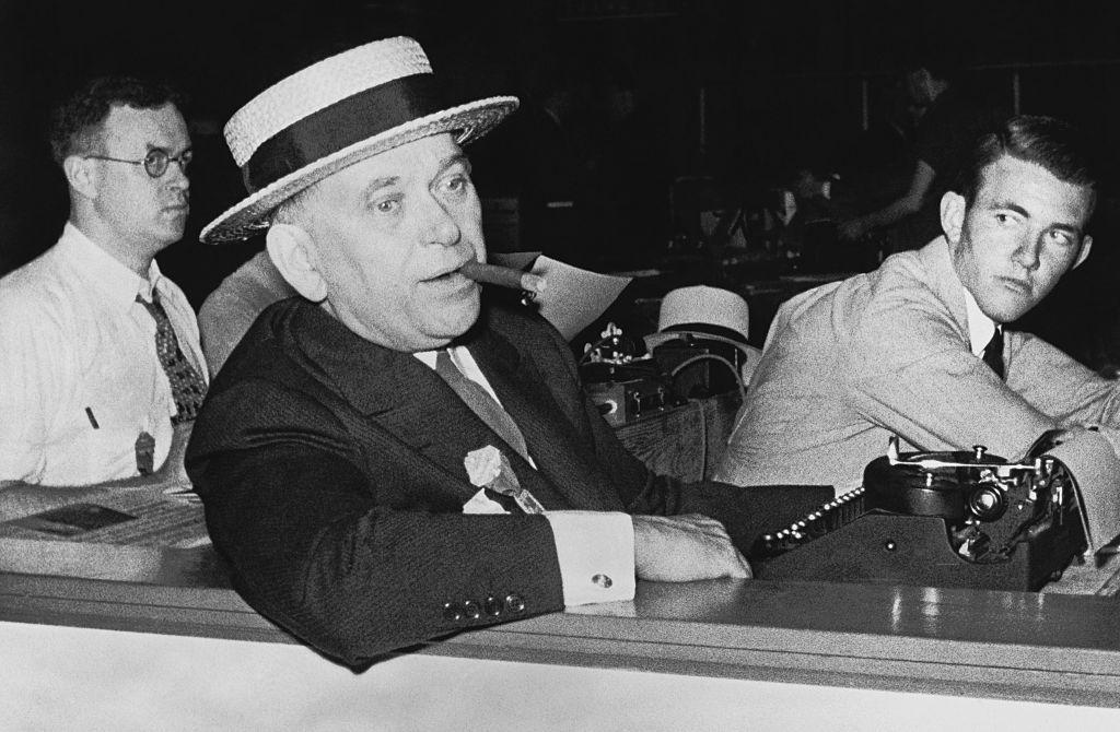 H.L. Mencken Smoking Cigar and Sitting at Typewriter