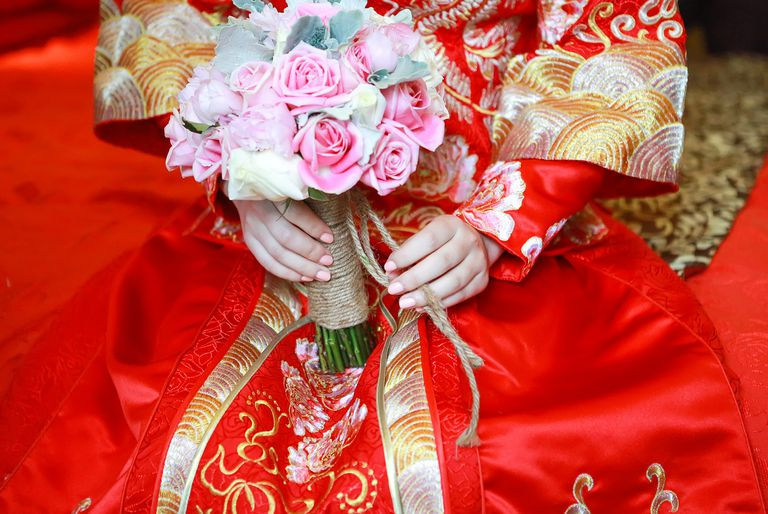 midsection of bride in traditional Chinese wedding dress