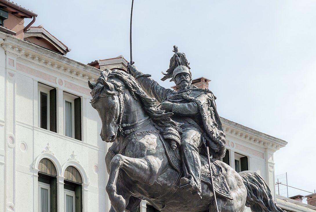 Statue of Victor Emmanuel II on his horse with his sword lifted.