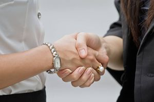 Close-up of professional women shaking hands