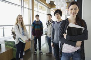 Portrait of high school students in corridor