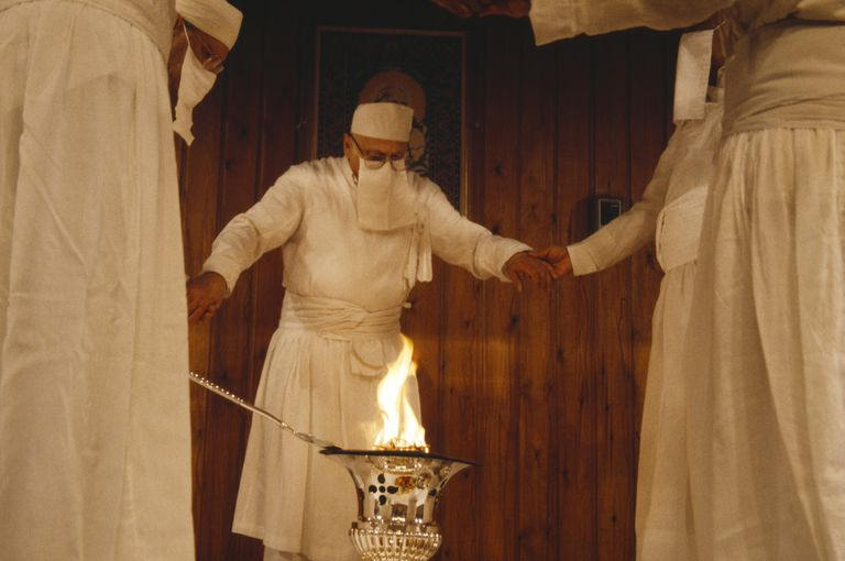 Zoroastrianism Parsis encircling fire in a temple.