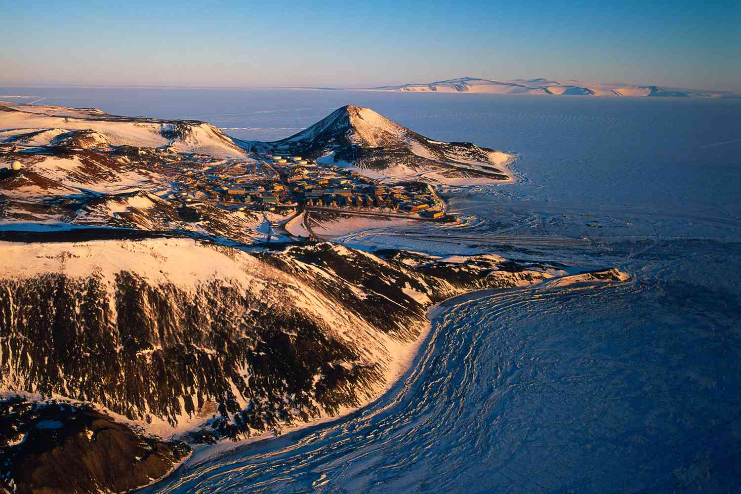 McMurdo Station on Ross Island in Antarctica surrounded by the Southern Ocean.