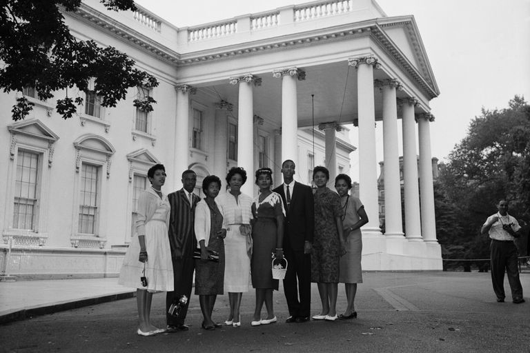 Daisy Bates and seven of the Little Rock Nine students standing together in front of the White House