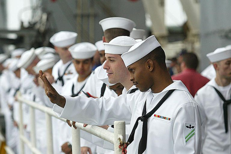Marine's wave as USS Constellation Returns Home From Persian Gulf Area