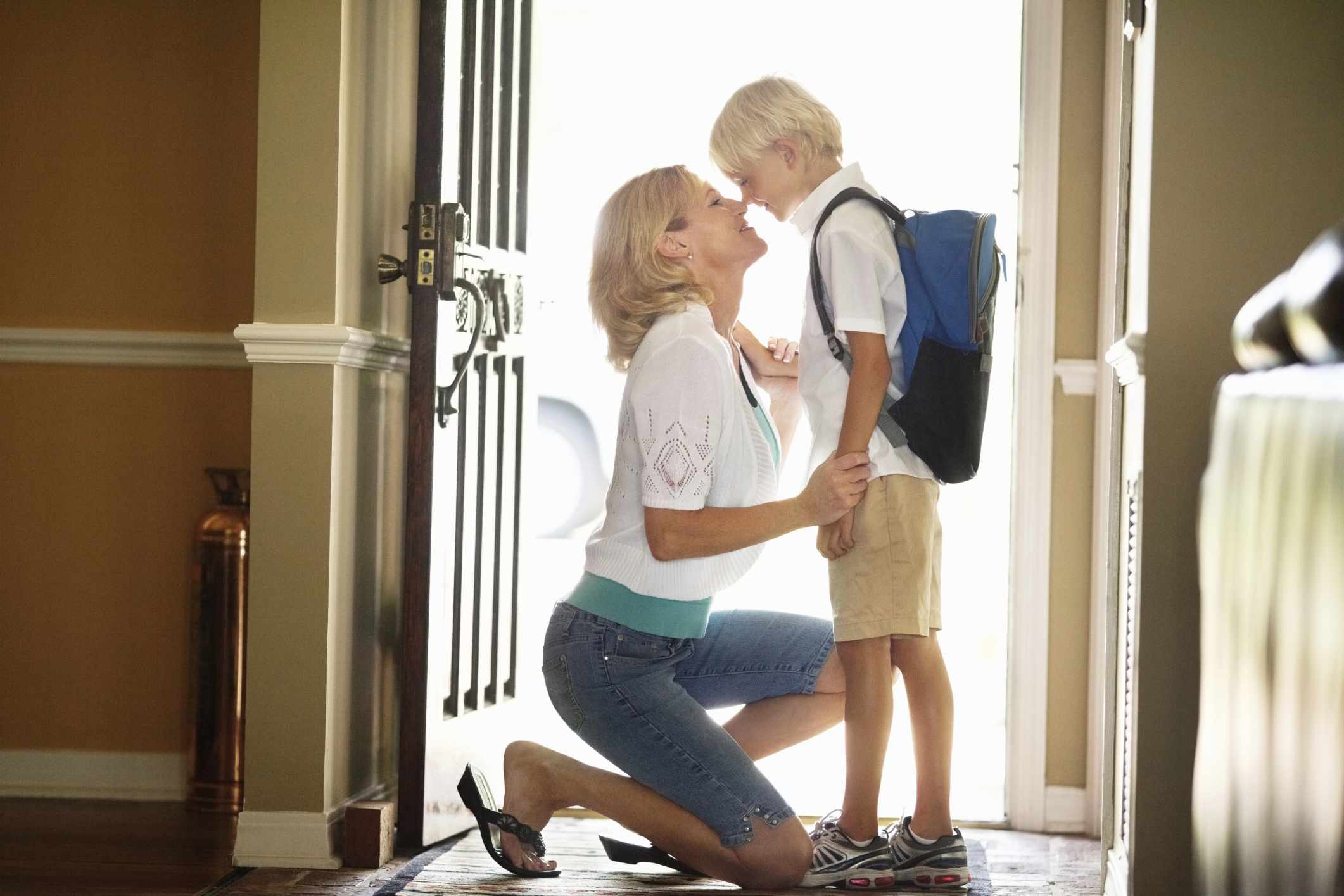 A young boy saying good bye to mom before school.