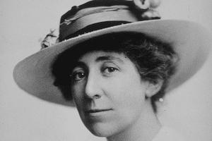 Black and white head shot of Jeannette Rankin taken in 1917.