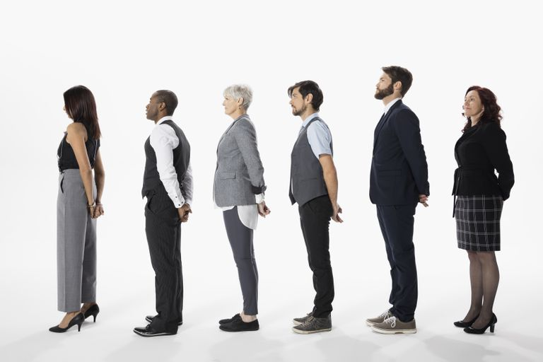 Business people standing in a row, waiting in queue against white background