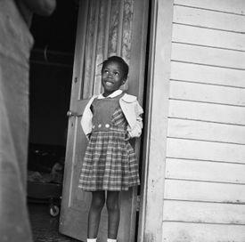 Ruby Nell Bridges next to open door.