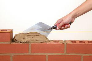 A brick wall under construction